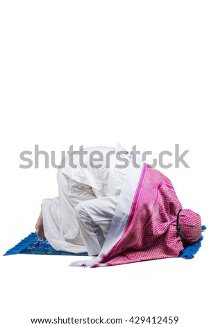 Image of Arabic person wearing islamic clothes and worshiping in the studio with prostration pose - stock photo