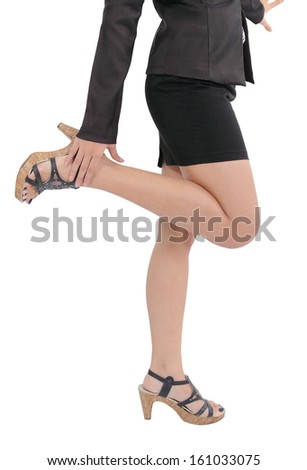 Image of asian business woman legs standing on white background