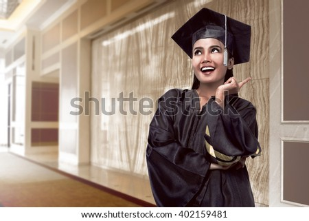 Image of asian college student graduate from university - stock photo