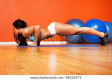 Image of athletic woman doing exercise - stock photo