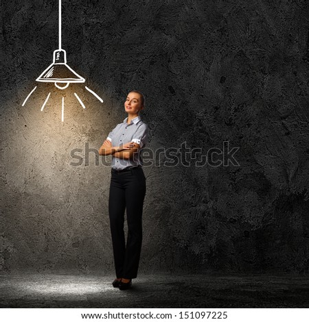 Image of attractive businesswoman against dark background - stock photo