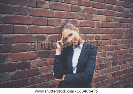 Image of attractive businesswoman in suit looking at camera   - stock photo
