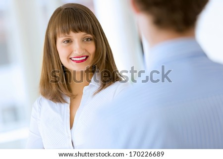 Image of attractive successful businesswoman in business suit smiling