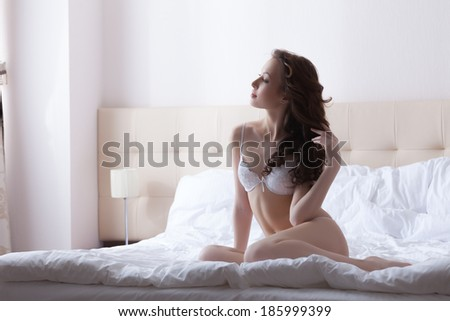 Image of attractive woman posing just waking up - stock photo
