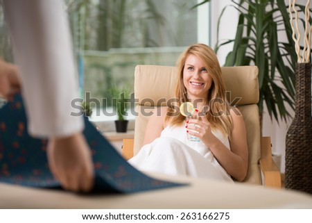 Image of attractive woman relaxing in wellness center - stock photo
