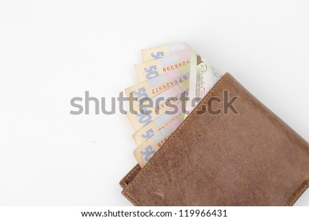 Image of 500 banknotes in brown wallet on Business theme