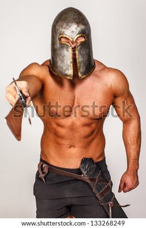 Image of barbarian who is pointing with his sword on someone - stock photo
