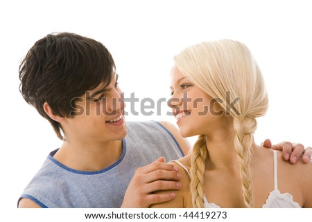 Image of beautiful blonde looking at handsome man while he embracing her