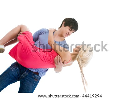 Image of beautiful blonde looking at handsome man while on his arms