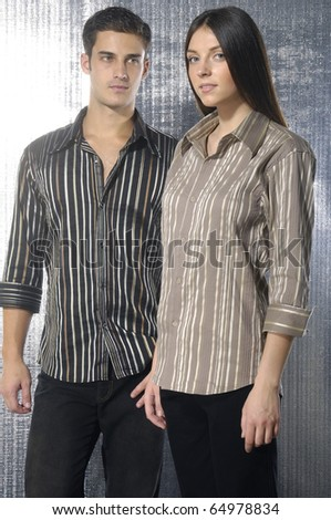 Image of beautiful fashion couple shot in studio - stock photo