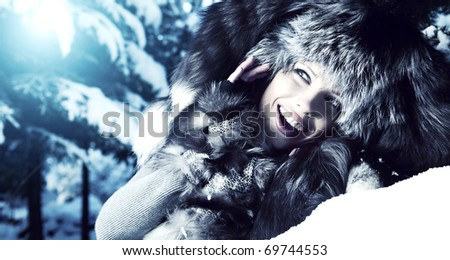 Image of beautiful female in luxurious fur head cloth looking at camera