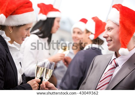 Image of beautiful female looking at her colleague while making toast - stock photo