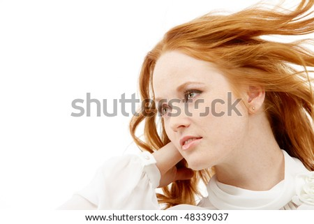Image of beautiful red-haired woman posing to camera
