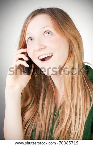 Image of Beautiful Woman Using her Mobile, with grey background - stock photo