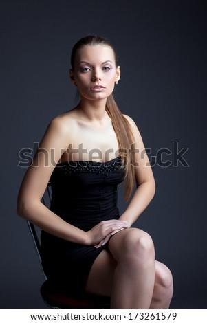 Image of beautiful young woman looking at camera - stock photo