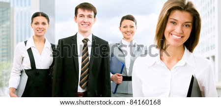 Image of beautyful business woman and her colleagues - stock photo