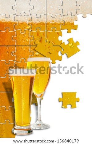 Image of beer formed by puzle pieces and two glasses in first plane     - stock photo