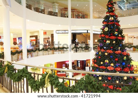 Image of big decorated Christmas tree in the mall - stock photo