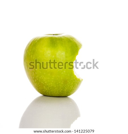image of bitten green apple on a white background - stock photo
