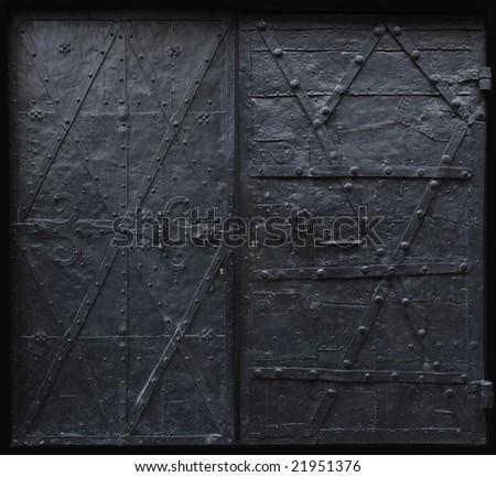 Image of black iron gothic security doors. - stock photo