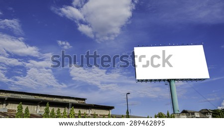image of blank advertisement billboard with blue sky in background .
