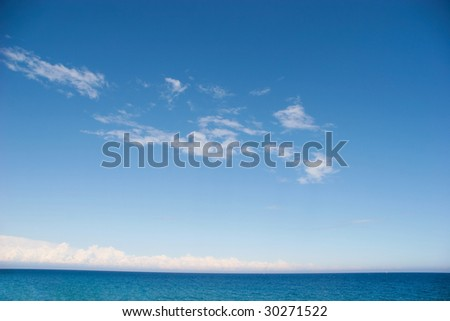Image of blue sea under azure sky on hot summer day - stock photo
