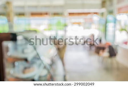 image of blur bakery shop with bokeh for background usage. - stock photo