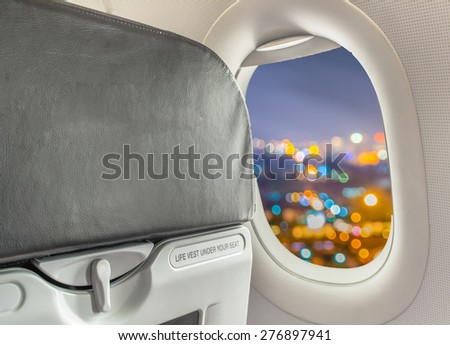 image of blur lights from Chiang Mai, Thailand looking from plane window for background usage.