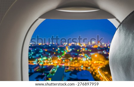 image of blur lights from Chiang Mai, Thailand looking from plane window for background usage. - stock photo
