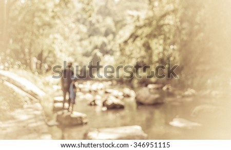 image of blur people at river and forest on day time for background usage . (black and white tone ) - stock photo