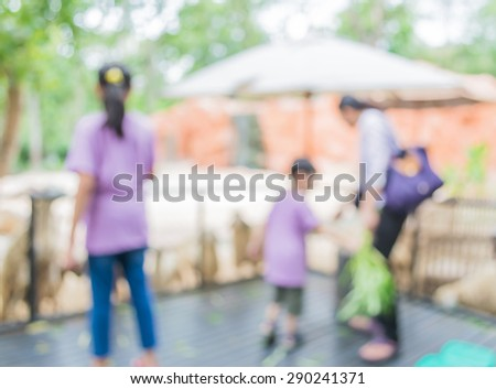 image of blur people feeding animals  with bokeh . - stock photo