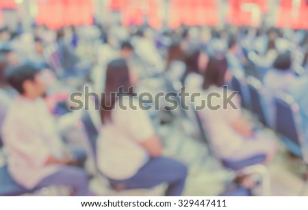 image of blur people looking to kid 's show on stage at school , for background usage . (vintage tone) - stock photo