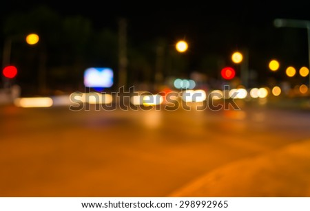 image of blur street  bokeh  with warm colorful lights in night time for background usage . - stock photo