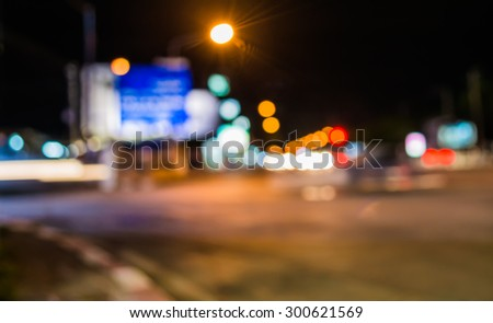 image of blur street  bokeh  with warm colorful lights in night time for background usage .