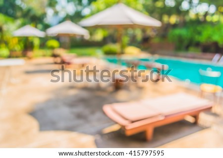 image of blur swimming pool in resort with bokeh for background usage . - stock photo
