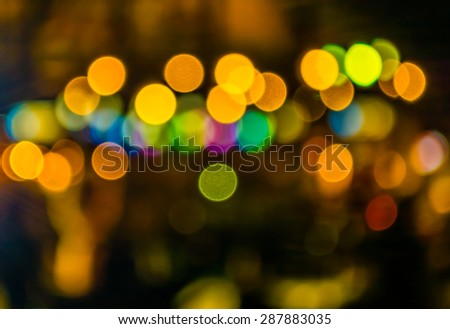 image of blurred bokeh background with warm colorful lights. - stock photo
