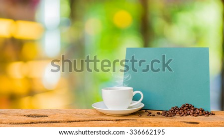 image of blurred coffee shop and chalkboard and  coffee cup with  for background usage .