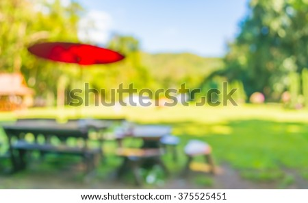 image of blurred outdoor coffee hut on day time , in garden for background usage . - stock photo