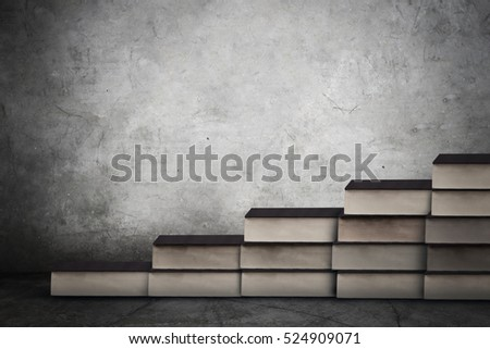Image of books stair with empty copy space on the wall. Concept of education process