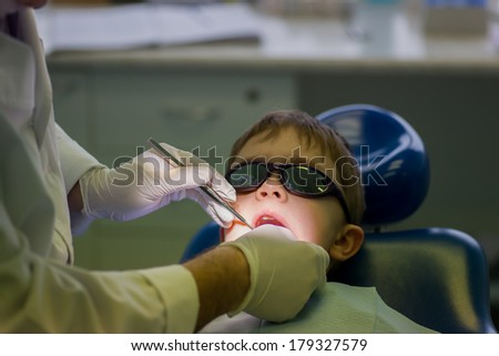 Image of Boy at the dentist, special lighting - stock photo