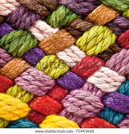 image of braided multi colored woollen yarns - stock photo
