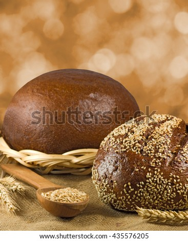 image of bread and wheat in spoon closeup