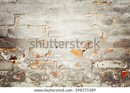 Image of brick wall with cracked plaster. Abstract background, masonry concept.  - stock photo