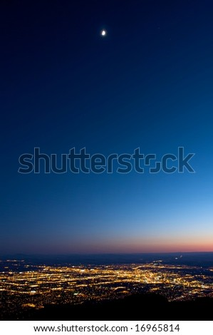 Image of bright city lights in a valley - stock photo