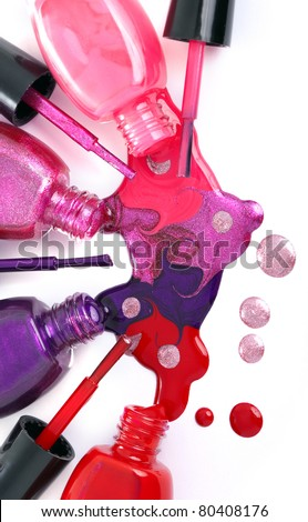 Image of bright-colored nail polish  spilling from bottles - stock photo