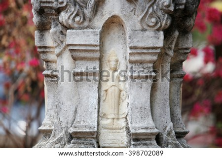 Image of Buddha sculpted on shrine of the household god - stock photo