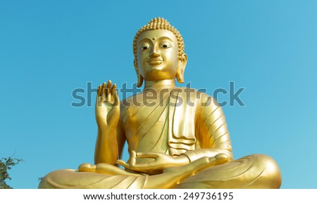 Image of Buddha with blue sky background - stock photo