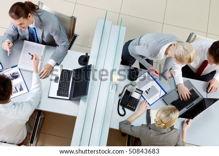 Image of business colleagues interacting with each other