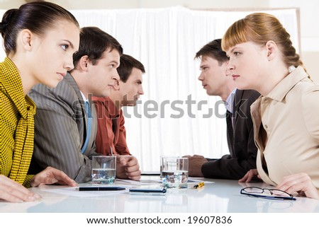 Image of business conflict between partners sitting opposite each other - stock photo