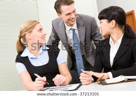 Image of business group communicating at meeting in the office